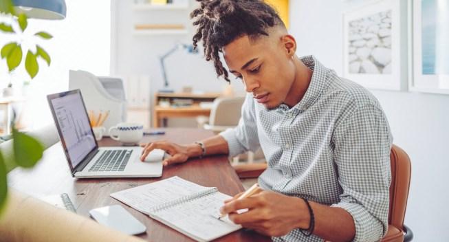 man-home-laptop-finances-notes