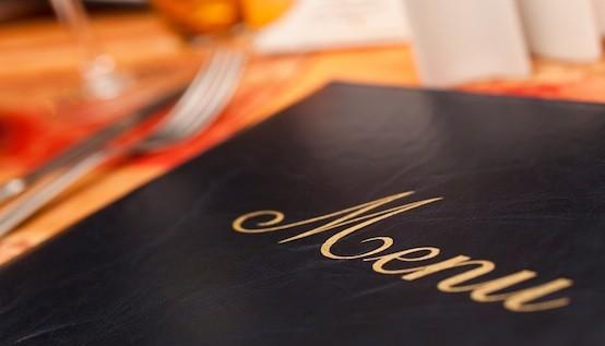 Menu & Cutlery on A Restaurant Table