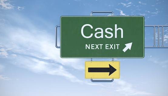 Cash next exit road sign