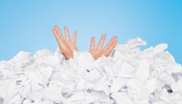 Human buried in papers