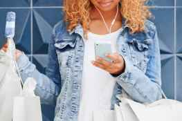 Double Denim trendy shopping Woman using smart phone