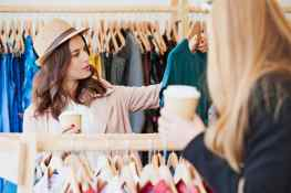Two Friends shopping in cute boutique clothing store