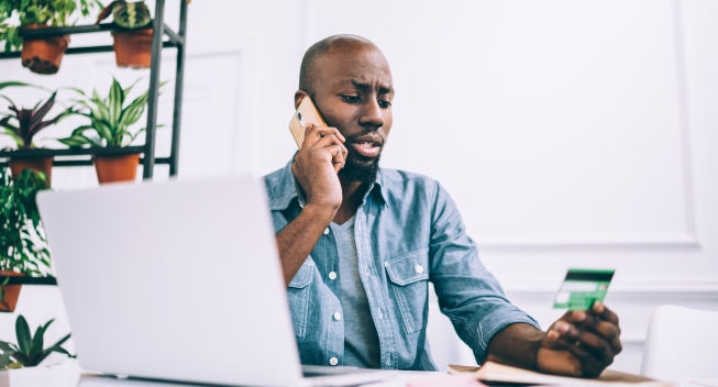 African,American,Guy,In,Casual,Outfit,Talking,On,Phone,And