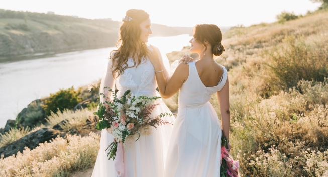 Lesbian,Wedding,Couple,In,White,Dresses