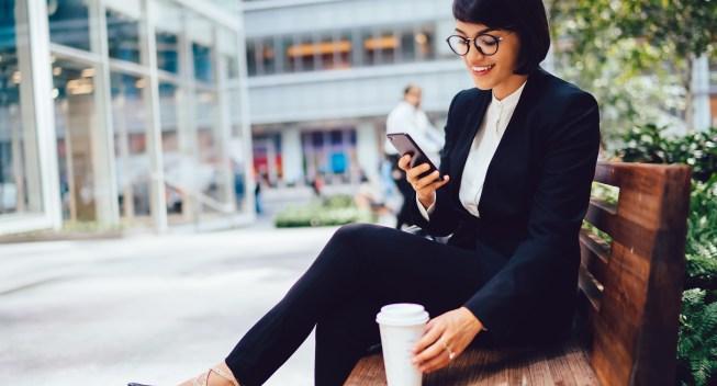 Smiling,Businesswoman,In,Elegant,Black,Suit,Resting,On,Coffee,Break