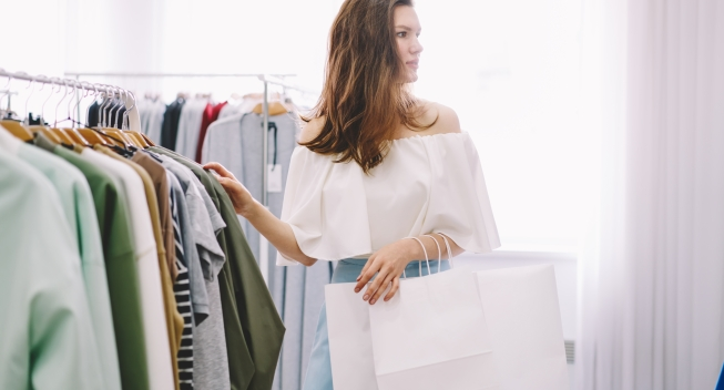 Side,View,Of,Charming,Lady,Holding,White,Paper,Shopping,Bags