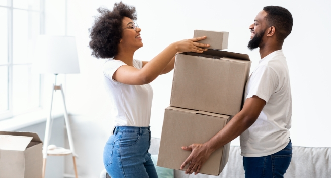 Happy,Black,Spouses,Packing,Boxes,For,Moving,,Relocating,To,New