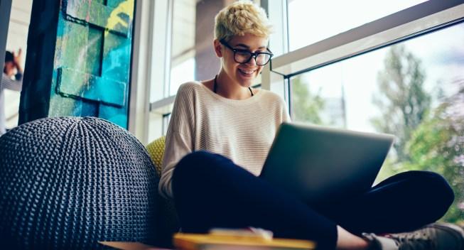 Smiling,Female,Student,In,Eyewear,Enjoying,Watching,Movie,Online,During