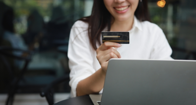 Asian,Woman,Shopping,Online,With,Credit,Card,And,Laptop,Computer