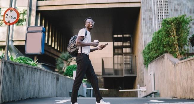 Positive,Dark,Skinned,African,American,Male,Walking,On,City,Street