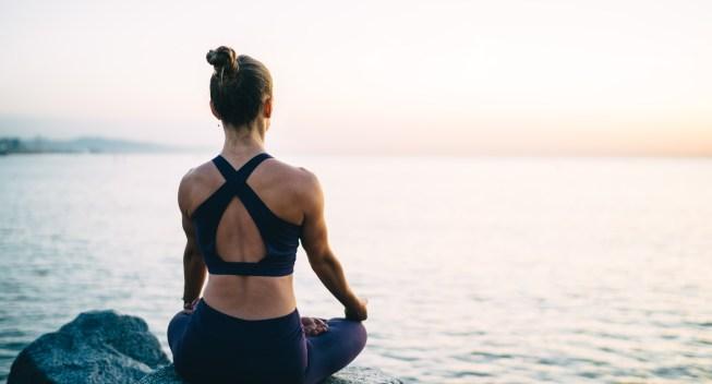 Muscular,Woman,Enjoying,Yoga,During,Morning,Sea,Breathing,Training,Body