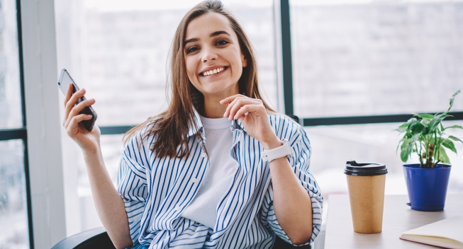 Cheerful,Caucasian,Woman,Satisfied,With,Good,Wireless,Connection,In,Office