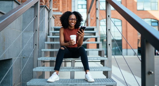 Young,Joyful,African,American,Female,In,Eyeglasses,Reading,Funny,Message