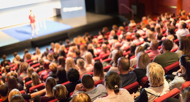 audience-listening-to-conference-speaker