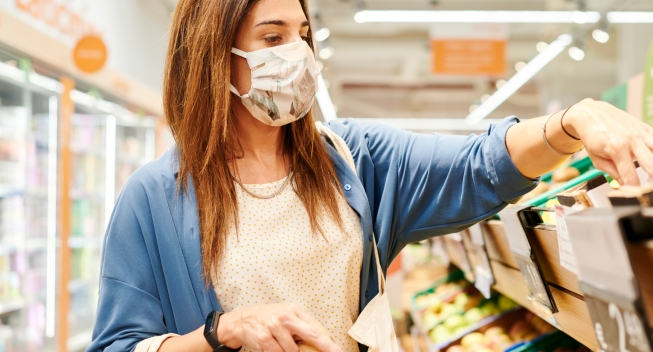 Woman In A Face Mask Shopping For Groceries