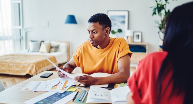 Serious,African,American,Hipster,Guy,Reading,Recept,Bill,For,Room
