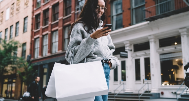 Happy,Slim,Attractive,Woman,In,Glasses,With,Shopping,Bags,Wearing