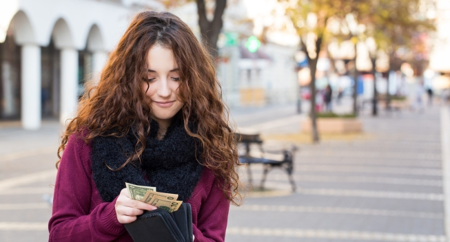 Young,Shopper,Woman,Taking,Out,Money,From,Wallet,On,Street
