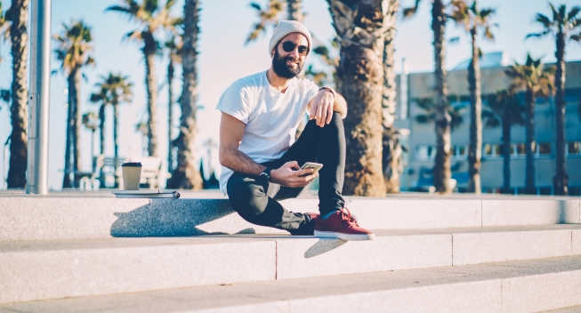 Portrait,Of,Stylish,Bearded,Student,In,Black,Sunglasses,Checking,Email