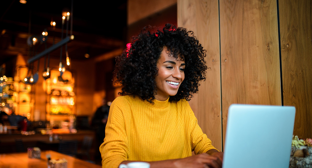 woman smiling while budgeting online