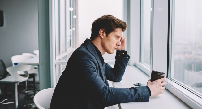 Contemplative,Businessman,In,Formal,Wear,Concentrated,On,Finding,Problem,Solution