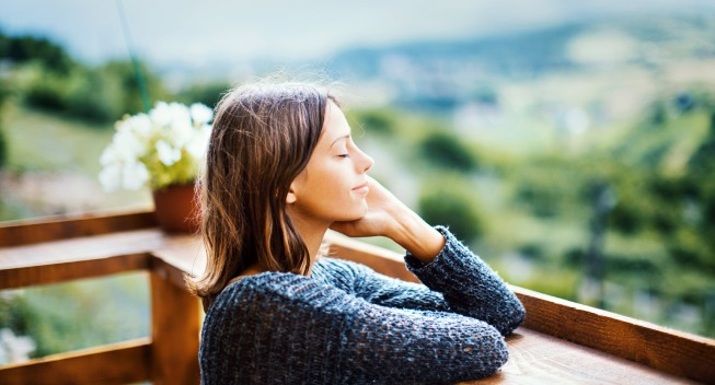 woman relaxing on balcony outdoors