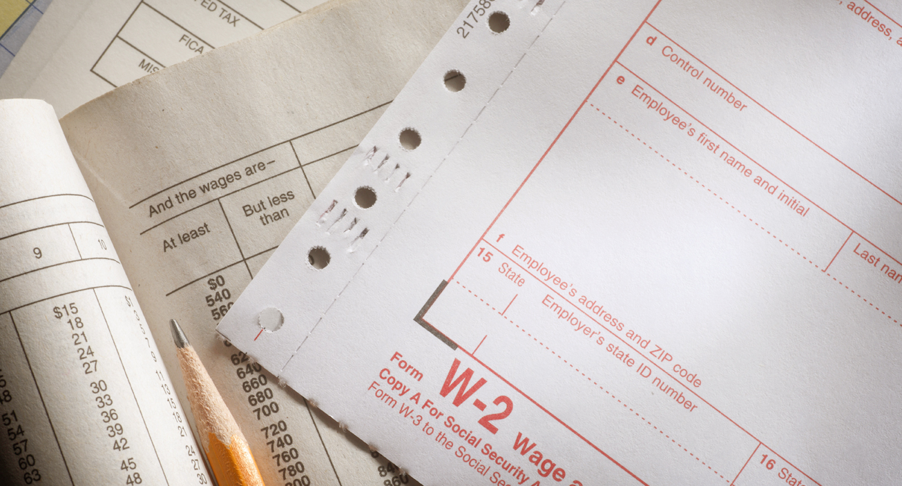 A W-2 on a payroll ledger and a federal withholding tax table.Please see some similar pictures from my portfolio:
