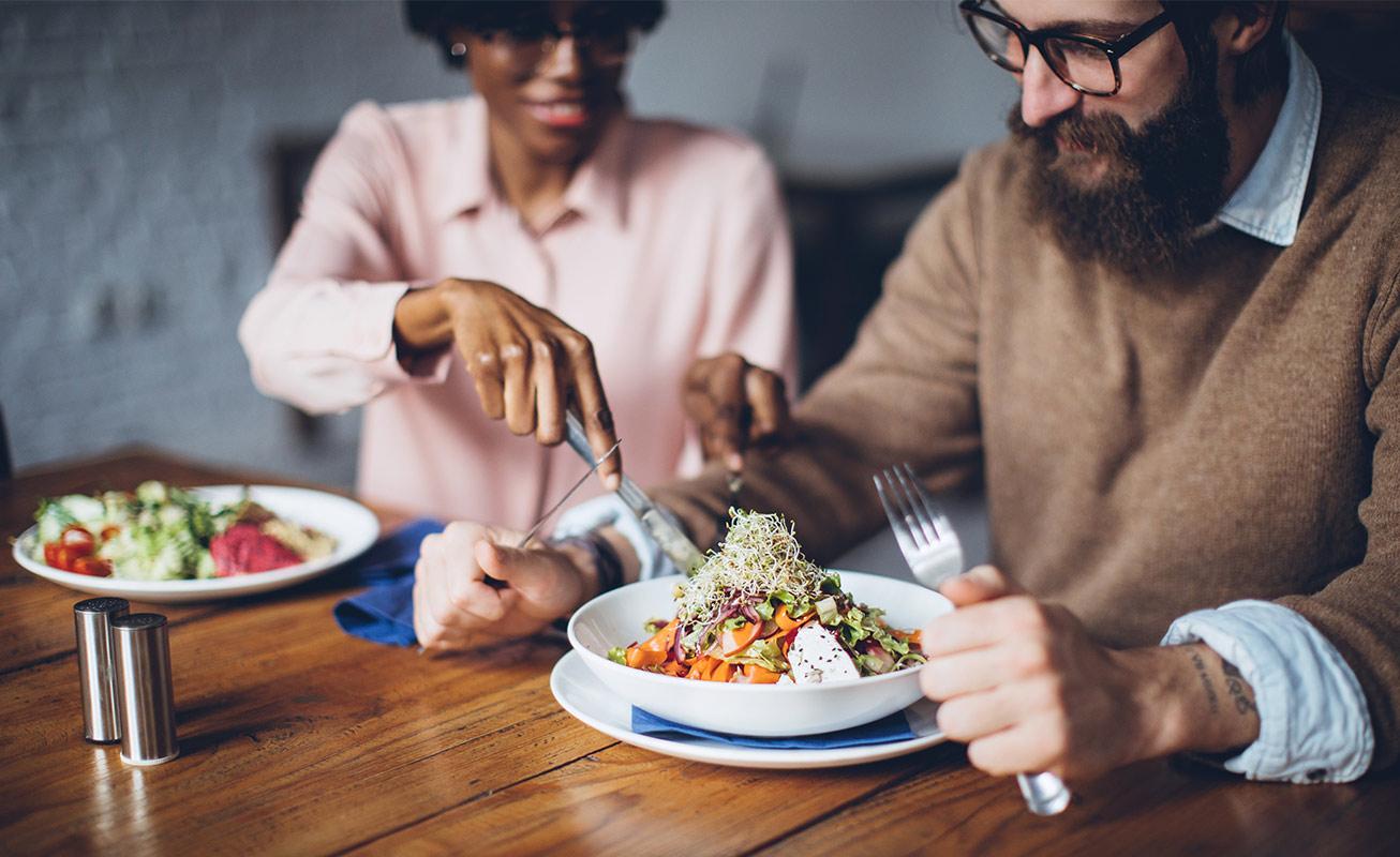 Happy couple having healthy vegetarian dinner
