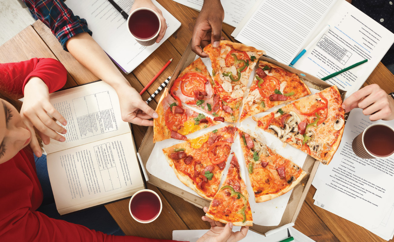 college students sharing pizza