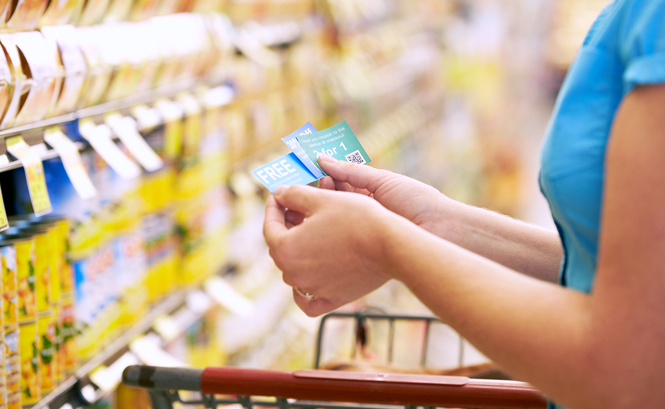 woman-using-coupons-in-store