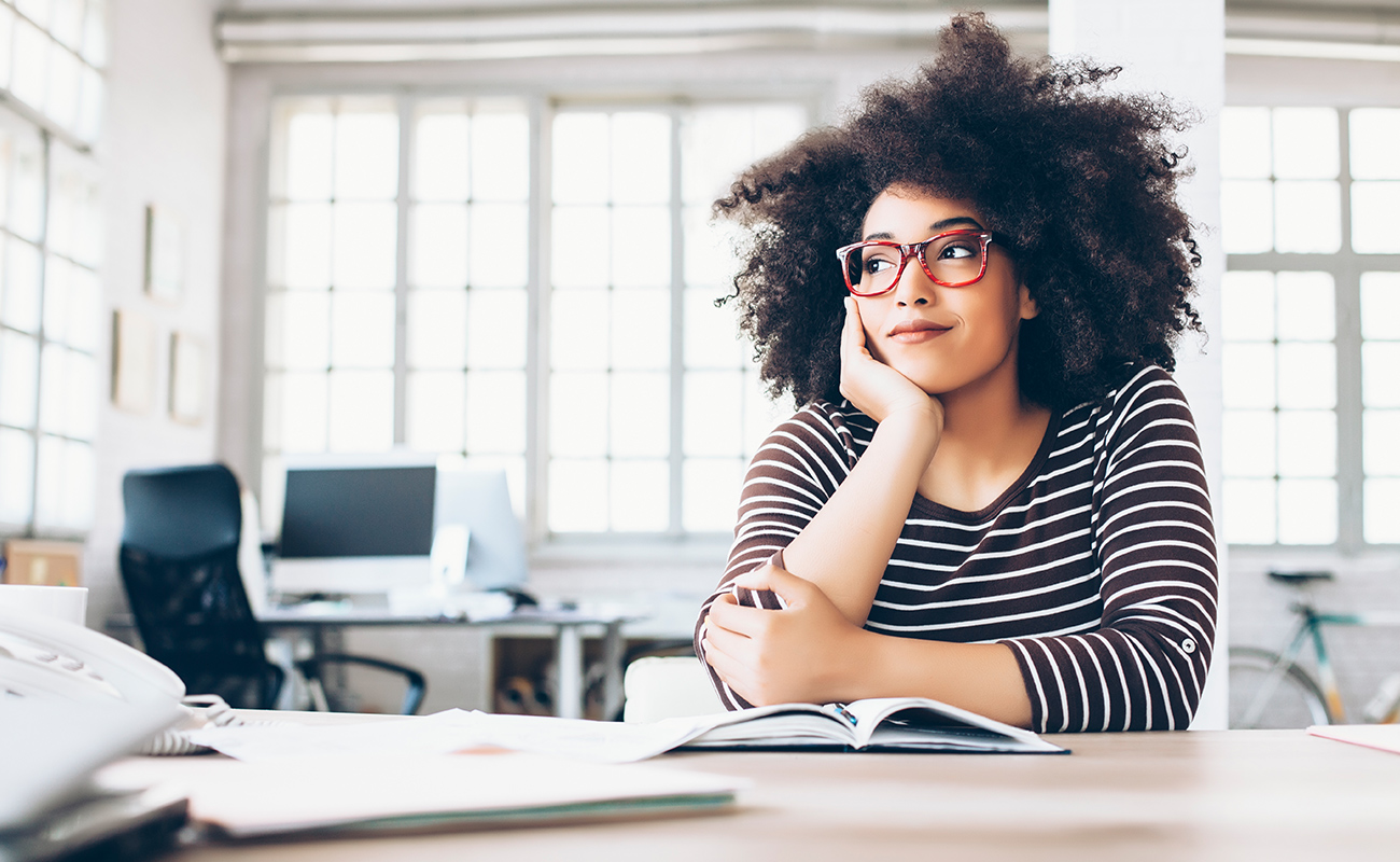 woman contemplating at a desk