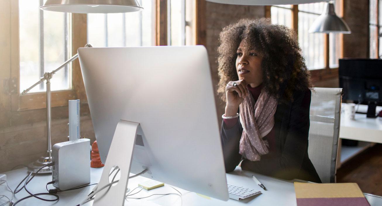 woman-at-computer-making-decision