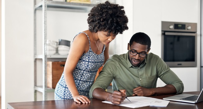 Couple looking over financial documents together