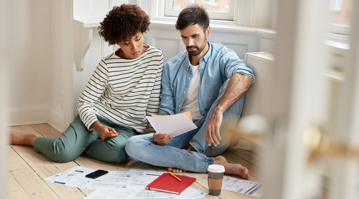 couple reviewing spending budget together