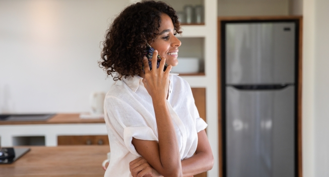 Woman Talking On The Phone In Her House