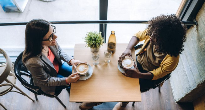 two-ladies-talking-over-coffee