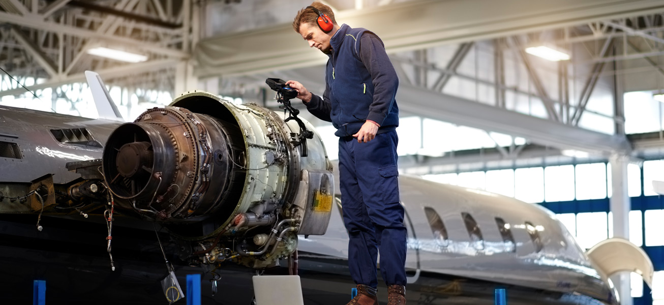 aircraft-mechanic-hangar-inspecting-repair