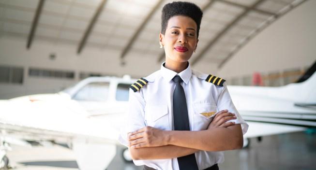 airplane-pilot-woman-hangar-confident