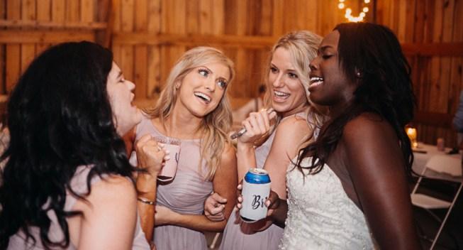 Bridesmaids And Bride Partying At Wedding