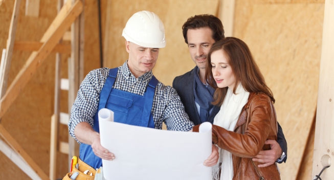 Worker,Shows,House,Design,Plans,To,A,Young,Couple,At