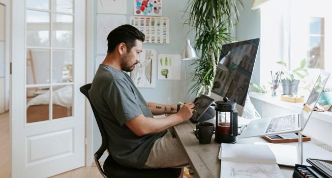 designer-working-computer-workspace-artist