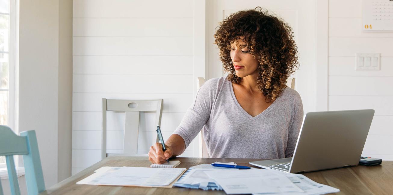 woman-finances-expenses-laptop-paperwork