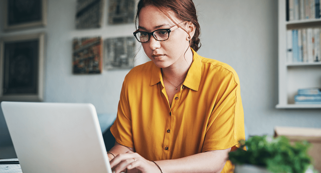 woman working on laptop from home